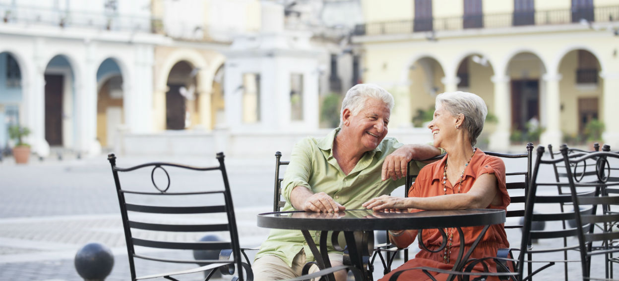 Older couple sitting at a cafe